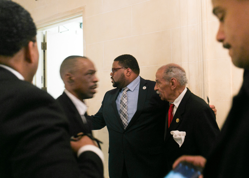 Rev. Charles Williams II, center left, ushers U.S. Rep. John Conyers through the crowd at the National Action Network Michigan Chapter's Dream Keepers Brunch and Award Ceremony in January at the Detroit Athletic Club, one of many venues in the city that were not welcoming to blacks in 1967. (Bridge photo by Brian Widdis)